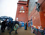 A solemn and emotional captain remembers as John Greig places flowers at the memorial statue at Ibrox Stadium to remember the 66 supporters who never made it back home on 2nd January 1971