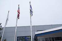 Flags fly outside the old headquarters of AMSC, also known as American Superconductor, in Devens, Massachusetts, USA, seen on Tues., Jan. 30, 2018. AMSC was the victim of the theft of trade secrets, starting in 2011 when the Chinese company Sinovel worked to steal and modify AMSC's proprietary wind turbine-running software. Sinovel was AMSC's largest customer, and McGahn estimates that 70% of China's wind turbines now run software stolen from AMSC. AMSC has received favorable judgments from American and Chinese courts, and the company contends that it is owed billions of dollars as a result of the theft, which almost destroyed the company. When news of the theft came out, the company's stock value decreased substantially and went from approximately 800 employees to fewer than 200. The company has rebounded some since the crime.