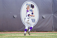 High Point Panthers left fielder Cody Manzella (13) catches a fly ball against the Coastal Carolina Chanticleers at Willard Stadium on March 14, 2014 in High Point, North Carolina.  The Panthers defeated the Chanticleers 3-0.  (Brian Westerholt/Four Seam Images)