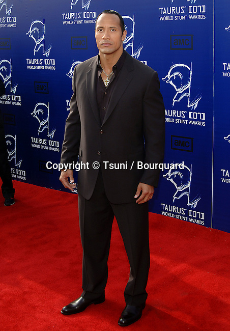Dwayne Johnson ( The Rock ) arriving at the 2007 TAURUS World Stunt Awards on the Paramount Lot  In Los Angeles. <br /> <br /> full length<br /> eye contact