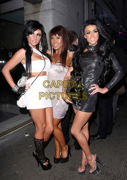 LEXI WARD, HANNAH SHAW & STACEY LACEY.Television X Shafta Awards 2011, For Your Eyes Only, 23 City Road, London, England..March 9th, 2011.shaftas full length black dress white sheer hand on hip skirt boots.CAP/AH.©Adam Houghton/Capital Pictures.