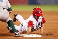 Auburn Doubledays outfielder Billy Burns #31 dives back to first during game two of the semi-final round of the NY-Penn League Playoff series against the Vermont Lake Monstes at Falcon Park on September 8, 2011 in Auburn, New York.  Auburn defeated Vermont 3-2.  (Mike Janes/Four Seam Images)