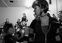 clockwise: [on the R] Lisa Lawless, Jennacologist [on the L], [in the background] Kitt Turbo (Co-Captain, Coach), Grrr Lee Burly, La Chica Mala, Whiskey T. Foxtrot, Deadly Nightshade [putting on makeup], Polly PureDread, Pandamonium in the locker room before the Bay Area Derby Girls season opener...(©Matt McKnight, 2008)