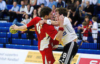 11 JUN 2010 - LONDON, GBR - Steve Larsson (Great Britain - red) looks for a way past Estonia's Kaupo Liiva (white and black) during the two teams 2012 European Handball Championships Qualification Tournament match (PHOTO (C) NIGEL FARROW)