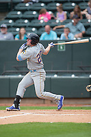 Billy McKinney (20) of the Myrtle Beach Pelicans follows through on his swing against the Winston-Salem Dash at BB&T Ballpark on April 18, 2015 in Winston-Salem, North Carolina.  The Pelicans defeated the Dash 4-1 in game one of a double-header.  (Brian Westerholt/Four Seam Images)