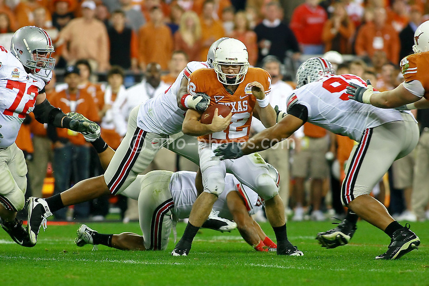Jan 05, 2009; Glendale, AZ, USA; Texas Longhorns quarterback Colt McCoy (12) is sacked by the Ohio State Buckeyes defense in the second quarter of the Fiesta Bowl at University of Phoenix Stadium.