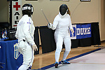 12 February 2017: UNC's Sara Elli Moreno (right) and Northwestern's Anna Tolley (left) during their Epee match. The University of North Carolina Tar Heels played the Northwestern University Wildcats at Card Gym in Durham, North Carolina in a 2017 College Women's Fencing match. UNC won the dual match 15-12 overall, 5-4 Foil, 5-4 Epee, and 5-4 Saber.