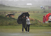 1st October 2017, Windross Farm, Auckland, New Zealand; LPGA McKayson NZ Womens Open, final round;  New Zealand's Lydia Ko shelters Megan Khang as play is suspended due to weather conditions