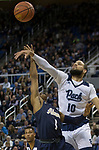 Akron guard Loren Cristian Jackson (1) shot is blocked by Nevada's forward Caleb Martin (10) in the second half of an NCAA college basketball game in Reno, Nev., Saturday, Dec. 22, 2018. (AP Photo/Tom R. Smedes)