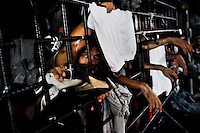 "A Mara gang member looks through the bars in a cell at the detention center in San Salvador, El Salvador, 20 February 2014. Although the country's two major gangs reached a truce in 2012, the police holding cells currently house more than 3000 inmates, five times more than the official built capacity. Partly because the ordinary Mara gang members did not break with their criminal activities (extortion, street-level distribution of drugs, etc.), partly because Salvadorean police still applies controversial anti-gang law which allows to detain almost anyone for ""suspicion of gang membership"". Accused young men are held in police detention centers where up to 25 inmates may share a cell of five-by-five metres. Here, in the dark overcrowded cages, under harsh and life-threatening conditions, suspected gang members wait long months, sometimes years, for trial or for to be transported to a regular prison."