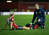2nd December 2017, Griffen Park, Brentford, London; EFL Championship football, Brentford versus Fulham; Sergi Canos of Brentford being seen by medics after being fouled