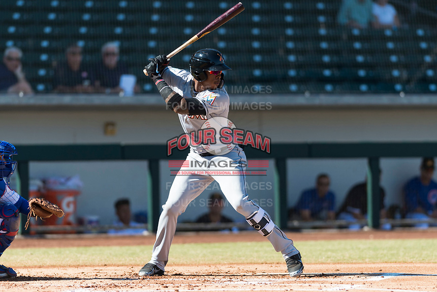 Salt River Rafters right fielder Monte Harrison (4), of the Miami Marlins organization, at bat during an Arizona Fall League game against the Mesa Solar Sox at Sloan Park on October 30, 2018 in Mesa, Arizona. Salt River defeated Mesa 14-4 . (Zachary Lucy/Four Seam Images)