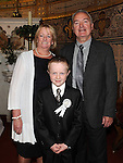 Nathan Byrne from Congress Avenue school who received first holy communion in St Mary's church pictured with grandparents Pat and Brigid Byrne