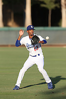 Brendon Davis (13) of the AZL Dodgers throws before a game against the AZL Diamondbacks at the Los Angeles Dodgers Spring Stadium Training Complex on July 3, 2015 in Glendale, Arizona. Diamondbacks defeated Dodgers, 5-1. (Larry Goren/Four Seam Images)