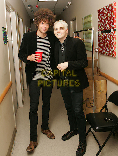ANDREW STOCKDALE & GERARD WAY.backstage at Night one of The 106.7 KROQ Almost Acoustic Christmas held at The Gibson Ampitheatre in Universal City, California, USA, December 09 2006.full length my chemical romance.CAP/DVS.©Debbie VanStory/Capital Pictures.**EXCLUSIVE**