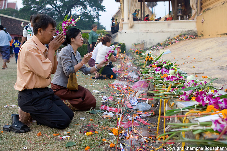 Buddhist faithfuls pray at the base of the stupa during boun That Luang in Vientiane, Laos on Monday, November 2, 2009.  The festival is the largest national holiday in Laos.  (Photo by Khampha Bouaphanh)