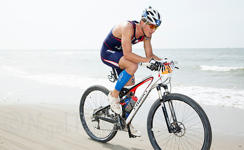 13 JUL 2013 - DEN HAAG, NED - Branden Rakita (USA)  of the USA  races along the beach during the bike at the 2013 ITU Elite Men's Cross Triathlon World Championships in Kijkduin, Den Haag (The Hague), the Netherlands (PHOTO COPYRIGHT © 2013 NIGEL FARROW, ALL RIGHTS RESERVED)