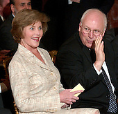 Washington, DC - September 29, 2005 -- United States Vice President Dick Cheney, right, shares a secret with first lady Laura Bush prior to the ceremony where John Glover Roberts, Jr. was sworn-in as the 17th Chief Justice of the United States in the East Room of the White House in Washington, D.C. on September 29, 2005.  .Credit: Ron Sachs / CNP