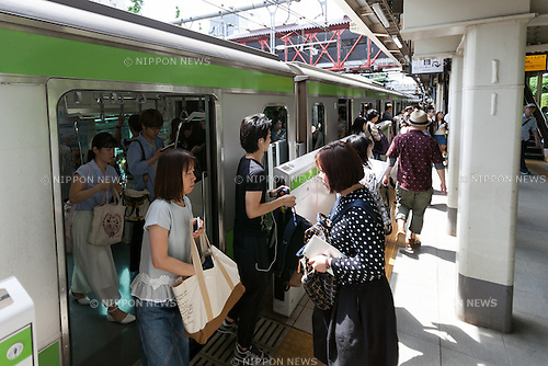 Passengers at Harajuku Station on June 10, 2016, Tokyo, Japan. East Japan Railway Co. announced on June 8 plans to rebuild the almost century-old Harajuku Station with the project set to be completed in time for the 2020 Olympic Games. The current wooden structure is believed to be the oldest wooden station building in Tokyo and was build in 1924 with an European architectural style, and the new station will be larger with an extra platform and a new gate on the west side. It has not yet been decided if the old structure will also be preserved as part of the project. JR East also plans to reform Chuo-Sobu Line's Sendagaya and Shinanomachi  stations in time for the 2020 Games at a total cost of 250 billion yen (2.3 billion USD) for the whole project. (Photo by Rodrigo Reyes Marin/AFLO)