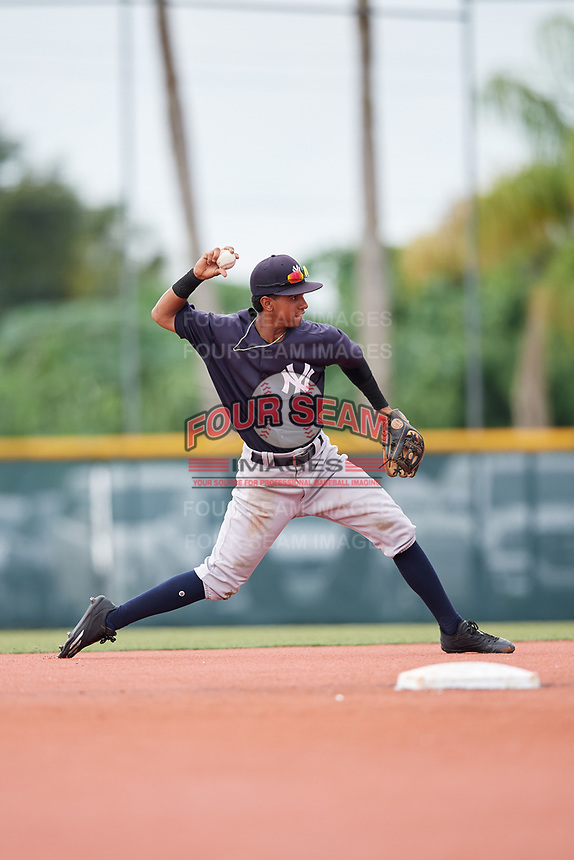 GCL Yankees East shortstop Borinquen Mendez (4) throws to first base during the first game of a doubleheader against the GCL Pirates on July 31, 2018 at Pirate City Complex in Bradenton, Florida.  GCL Yankees East defeated GCL Pirates 2-0.  (Mike Janes/Four Seam Images)