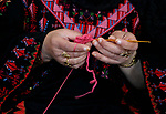 Jihad Awad, 50, a Palestinian woman of special needs, works on embroidery on the occasion of International Women's Day, in al-Bureij refugee camp, in the center of Gaza strip, on March 8, 2018. International Women's Day is annually held on March 8 to celebrate women's achievements throughout history and across nations. It is also known as the United Nations (UN) Day for Women's Rights and International Peace. Photo by Mahmoud Khattab