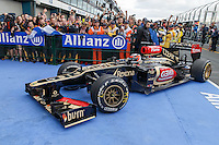 MELBOURNE, 17 MARCH - Kimi Raikkonen (FIN) from the Lotus F1 Team enters parc ferme as the winner of the 2013 Formula One Rolex Australian Grand Prix at the Albert Park Circuit in Melbourne, Australia. Photo Sydney Low/syd-low.com