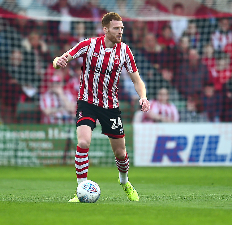 Lincoln City's Cian Bolger<br /> <br /> Photographer Andrew Vaughan/CameraSport<br /> <br /> The EFL Sky Bet League Two - Lincoln City v Macclesfield Town - Saturday 30th March 2019 - Sincil Bank - Lincoln<br /> <br /> World Copyright © 2019 CameraSport. All rights reserved. 43 Linden Ave. Countesthorpe. Leicester. England. LE8 5PG - Tel: +44 (0) 116 277 4147 - admin@camerasport.com - www.camerasport.com