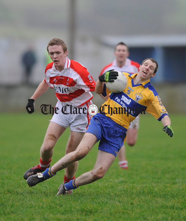 Alan Barry of Cork IT and Clare's  Niall Considine meet during their Mc Grath Cup game at Cooraclare. Photograph by John Kelly.....