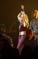 June 8, 2002, Montreal, Quebec, Canada<br /> <br /> Sheryl Crow perform for the guest of  a private party held a Mel's studio (where studio scenes of The Sums of All Fear where shot)<br /> during the F-1 Grand Prix week end Montreal, Canada, June 8, 2002.<br /> <br /> (Pierre Roussel - ImagesDistribution<br /> <br /> NOTE Nikon D-1 jpeg opened with Qimage icc profile, saved in Adobe 1998 RGB.