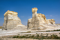 Monument Rocks or the Chalk Pyramids near Oakley Kansas seem very out of place, rising 70 feet from the flat Kansas prairie.  The Niobrara Chalk formations were formed around 80 million years ago when Kansas was an inland sea leaving a large number of fossils .  The site was the first National Natural Landmark designated by the Dept. of Interior.