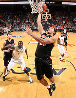 Dec. 22, 2010; Charlottesville, VA, USA; Seattle Redhawks forward Brandon Durham (25) shoots the ball in front of Virginia Cavaliers center Assane Sene (5) during the game at the John Paul Jones Arena. Seattle Redhawks won 59-53. Mandatory Credit: Andrew Shurtleff