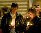 Sago, WVa - January 4, 2005 -- Unidentified participants attend the candlelight vigil and prayer service honoring the 13 lost coal miners outside Sago Baptist Church in Sago, West Virginia on January 4, 2006.  .Credit: Ron Sachs / CNP