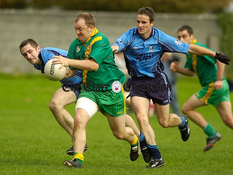 Kildysarts Noel O'Grady and Brendan Frawley chase O'Callaghans Mills Barry O'Donnell at Clareabbey.Pic Arthur Ellis.