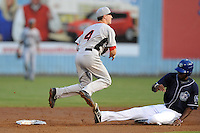 Hickory Crawdads second baseman Nick Urbanus #4 makes the turn and completes a double play over a hard sliding Francisco Sosa during a game against the Asheville Tourists at McCormick Field on August 22, 2013 in Asheville, North Carolina. The Tourists won the game 7-4. (Tony Farlow/Four Seam Images)