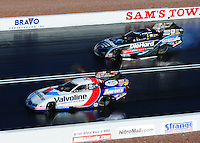 Apr. 1, 2011; Las Vegas, NV, USA: NHRA funny car driver Matt Hagan (right) races alongside Jack Beckman during qualifying for the Summitracing.com Nationals at The Strip in Las Vegas. Mandatory Credit: Mark J. Rebilas-
