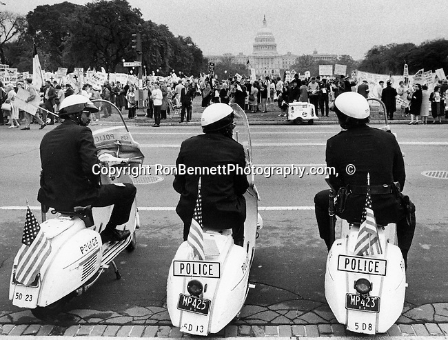 United States Capitol police watch a demonstration with US Capitol in background,  U.S. Capitol is the meeting place of the United States Congress, legislature of the Federal government, Fine Art Photography by Ron Bennett, Fine Art, Fine Art photography, Art Photography, Copyright RonBennettPhotography.com ©