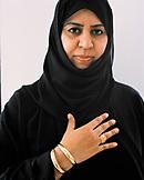 OMAN, Muscat, mid adult woman in burkha, portrait