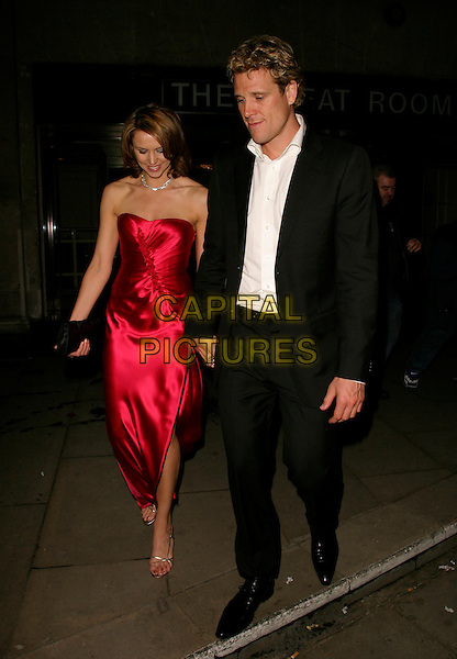 BEVERLY TURNER & JAMES CRACKNELL.Leaving the British Academy Television Awards (Bafta's),.Grosvenor House Hotel, London, England, May 7th 2006..bafta baftas full length red dress side slit split thigh leg   beverley.REf: AH.www.capitalpictures.com.sales@capitalpictures.com.©Adam Houghton/Capital Pictures.