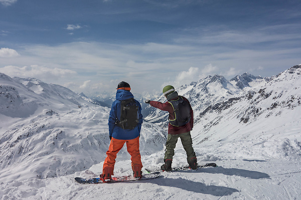 Vast areas are open to those with the skill and daring. Snowboarders atop St Anton Ski Area, Austria.
