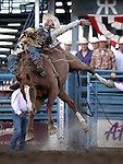 Joe Gunderson, of Agar, South Dakota, competes in the saddle bronc event at the Reno Rodeo on Friday, June 17, 2011 in Reno, Nev. .Photo by Cathleen Allison