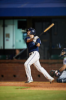 Mobile BayBears first baseman Zach Houchins (8) follows through on a swing during a game against the Pensacola Blue Wahoos on April 25, 2017 at Hank Aaron Stadium in Mobile, Alabama.  Mobile defeated Pensacola 3-0.  (Mike Janes/Four Seam Images)