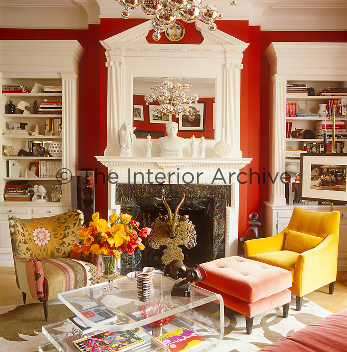 The stunning custom-made fireplace and overmantel create an elegant focal point in the living room and are flanked with a pair of matching white bookcases