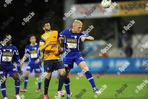 2013-08-15 / Voetbal / seizoen 2013-2014 / KV Turnhout - Woluwe-Zaventem / Roel Van Hemert (r. KVT) met Benlouafi<br /><br />Foto: mpics.be