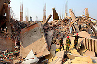 Rescue workers from the Bangladeshi Army sift through the wreckage of the Rana Plaza complex in search of survivors. The 8 storey building, which housed a number of garment factories employing over 3,000 workers, collapsed on 24 April 2013. By 29 April, at least 380 were known to have died while hundreds remained missing. Workers who were worried about going to work in the building when they noticed cracks in the walls were told not to worry by the building's owner, Mohammed Sohel Rana, who is a member of the ruling Awami League's youth front. He fled his home and tried to escape to neighbouring India after the building collapsed but was caught by police and brought back to Dhaka. Some of the factories working in the Rana Plaza building produce cheap clothes for various European retailers including Primark in the UK and Mango, a Spanish label. . /Felix Features