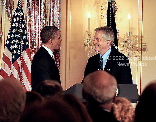 United States President Barack Obama is welcomed by U.S. Deputy Secretary of State William J. Burns prior to delivering remarks at the Diplomatic Corps Holiday Reception in Washington, D.C, on Wednesday, December 19, 2012..Credit: Ron Sachs / CNP