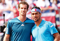 Britain's Andy Murray and Italy's Fabio Fognini during their Davis Cup quarter-final tennis match in Naples April 6, 2014.