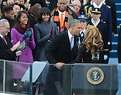 President Barack Obama greets Beyonce after she sang the National the National Anthem during the public inauguration ceremony at the U.S. Capitol Building in Washington, D.C. on January 21, 2013.     .Credit: Pat Benic / Pool via CNP