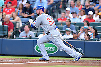 Chicago Cubs starting pitcher Jon Lester (34) swings at a pitch during a game against the Atlanta Braves on July 18, 2015 in Atlanta, Georgia. The Cubs defeated the Braves 4-0. (Tony Farlow/Four Seam Images)