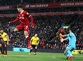 17th March 2018, Anfield, Liverpool, England; EPL Premier League football, Liverpool versus Watford; Roberto Firmino of Liverpool scores with a back-heel flick from close range to give his team a 3-0 lead past keeper Karnezis in the 49th minute