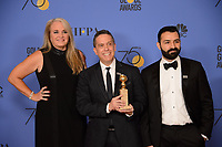 Darla K. Anderson, Lee Unkrich, and Adrian Molina pose with the Golden Globe award For BEST ANIMATED FEATURE FILM, for &quot;Coco,&quot; backstage in the press room at the 75th Annual Golden Globe Awards at the Beverly Hilton in Beverly Hills, CA on Sunday, January 7, 2018.<br /> *Editorial Use Only*<br /> CAP/PLF/HFPA<br /> &copy;HFPA/PLF/Capital Pictures